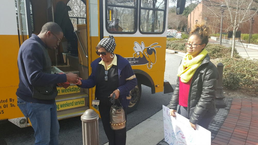 SHOWING KINDNESS: Members of a student organization show appreciation to campus transit drivers with small gifts and thank you notes.