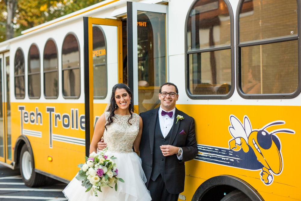 """WEDDING BELLS: Simon and Serina Awadalla used the Tech Trolley in their November 2019 wedding. """"Most of our bridal party are GT alums,"""" said Simon (ME 2009). """"We all have Yellow Jacket pride, so we sang the fight song the entire time we were onboard."""""""