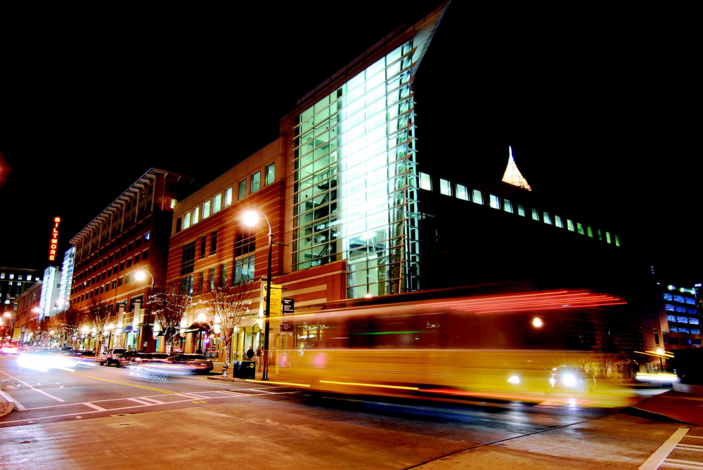 LIGHT UP THE NIGHT: The Tech Trolley rambles through Tech Square on its nighttime route.